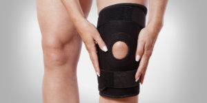 Knee brace on a person's knee
